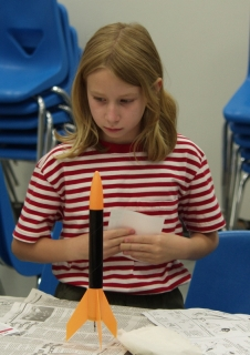 A young girl and her rocket